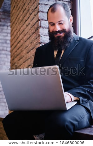 Young Man in Black Shirt and Tie  Stock photo © NicoletaIonescu