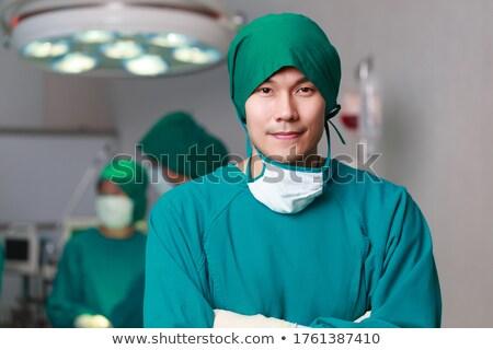 ázsiai női sebész áll keresztbe tett kar orvos Stock fotó © bmonteny