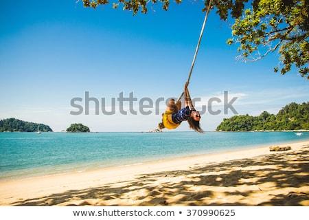 mulher · praia · pôr · do · sol · menina · verão · viajar - foto stock © silkenphotography
