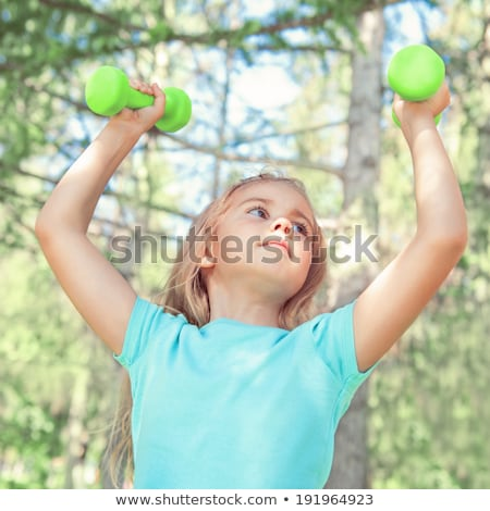 happy little girl lifting dumbbells in park outdoors stock photo © hasloo