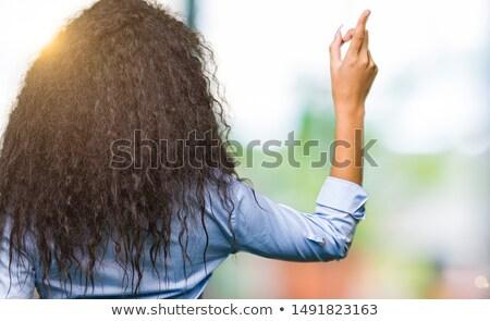 Lány néz visszafelé közelkép fiatal barna hajú Stock fotó © milsiart