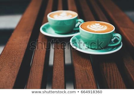 Kahve fincanı fincan tabağı ahşap masa yaprak sevmek ahşap Stok fotoğraf © jarin13