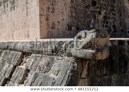 mayan snake head sculpture on ball court stock photo © quasarphoto
