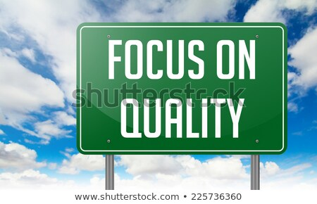 we focus on quality in highway signpost stock photo © tashatuvango
