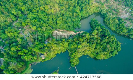 Top view on fields and hills in mist Stock photo © BSANI