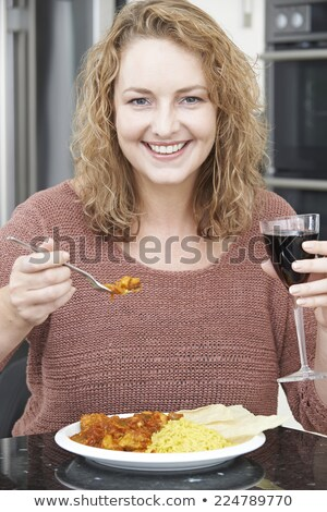 Woman Eating Takeaway Curry And Drinking Wine Stock photo © HighwayStarz
