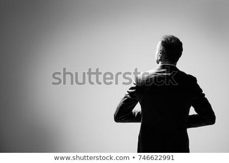 elegant business man holding his right arm stock photo © feedough