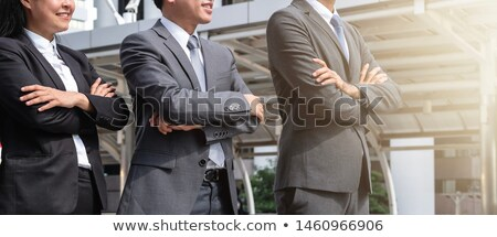 Three business professionals crossing arms posture Stock photo © tangducminh