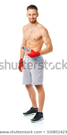 Sport attractive man wearing boxing bandages and drinking fresh  Stock photo © vlad_star