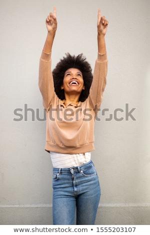 Girl with arms raised. Stock photo © iofoto