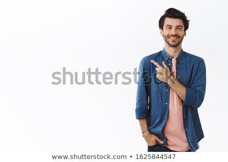 Feliz barbudo cara indicação alguém inclinando-se para trás Foto stock © ozgur