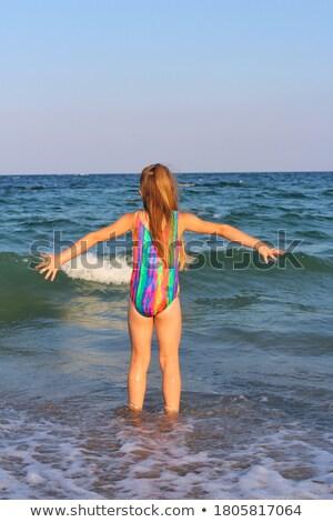 Happy blonde leaping on the beach in bikini Stock photo © wavebreak_media
