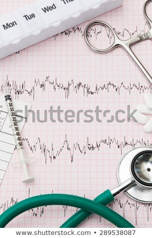 Medical Equipment Arranged On Pulse Trace Output Stock photo © HighwayStarz