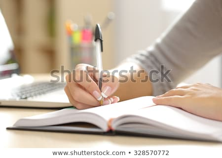 Stock photo: Exam note on agenda and pen