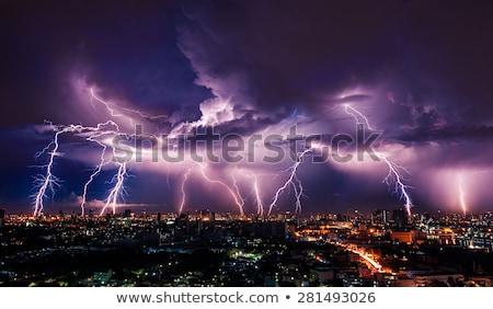 Lightning strike over night city Stock photo © tetkoren
