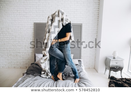 Two lovers under the wall of a beautiful interior Stock photo © bezikus