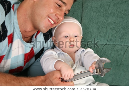 father with baby with extension wrench stock photo © paha_l