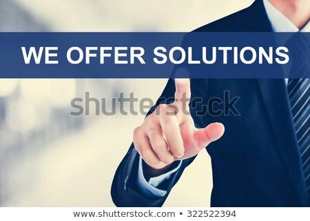 üzletember · mutat · szavak · ajánlat · megoldások · sötét - stock fotó © fotoquique