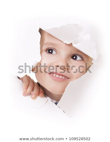 child looks in a hole in a sheet of a paper Stock photo © Paha_L