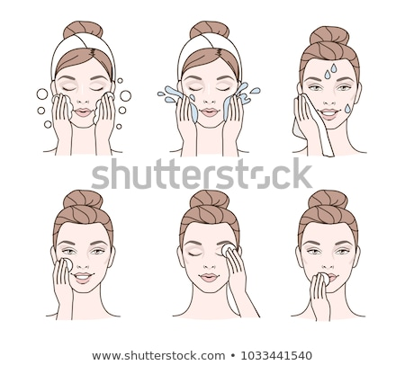 Beautiful girl wiping lips with tissue Stock photo © svetography