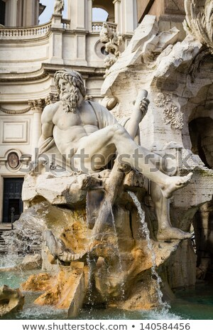 fountain zeus in berninis piazza navona in rome italy stock photo © vladacanon