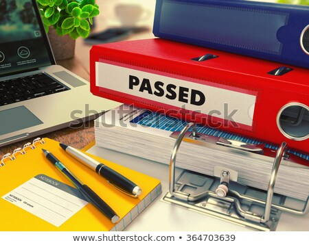 red office folder with inscription passed stock photo © tashatuvango