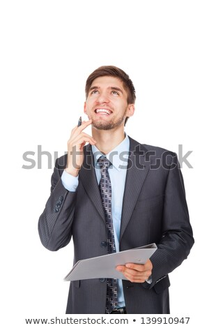Pensive businessman holding clipboard and looking up Stock photo © deandrobot