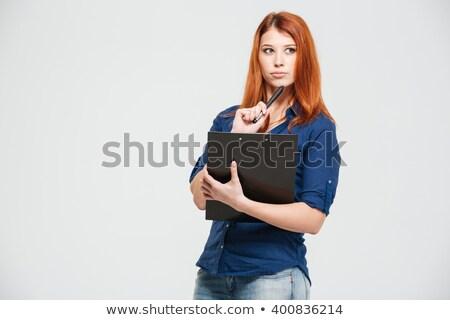 Peinzend mooie jonge vrouw Stockfoto © deandrobot
