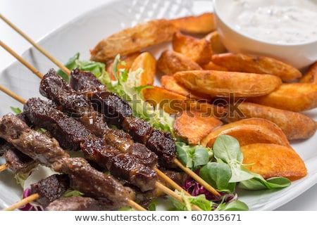 shish kebab and potato wedges stock photo © digifoodstock