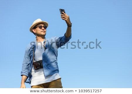 homem · bonito · férias · dia · feliz · parede · retrato - foto stock © konradbak