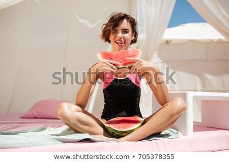 красивой · брюнетка · женщину · позируют · Бикини · серый - Сток-фото © deandrobot