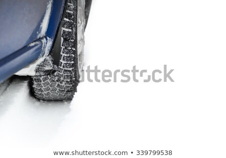 blue car with winter tires on the snowy road drive safe space for text stock photo © maxpro