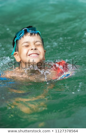 close up of young boy swimming in sea stock photo © orla