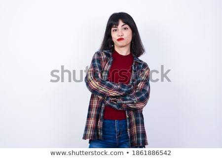 Thoughtful young woman in plaid shirt standing with arms crossed Stock photo © deandrobot