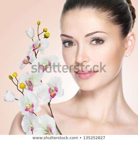 Bella donna bellezza orchidea fiore donna fiori Foto d'archivio © Elnur