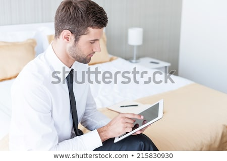 Young businesswoman sitting at the hotel room with suitcase Stock photo © deandrobot