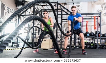 Man with battle rope in functional training fitness gym Stock photo © vlad_star
