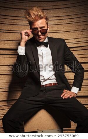 üzletember · elvesz · el · szemüveg · fiatal · mosolyog - stock fotó © feedough