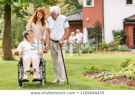 Geriatric caregiver with senior couple Stock photo © yamayo74