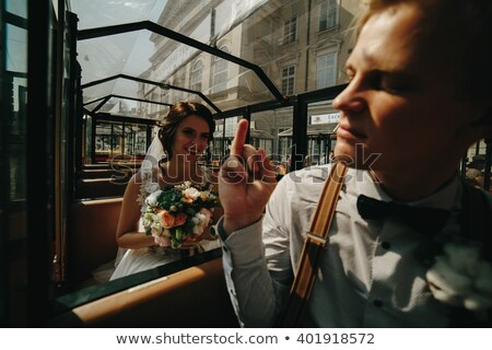 Bride and groom posing in a tour car Stock photo © tekso
