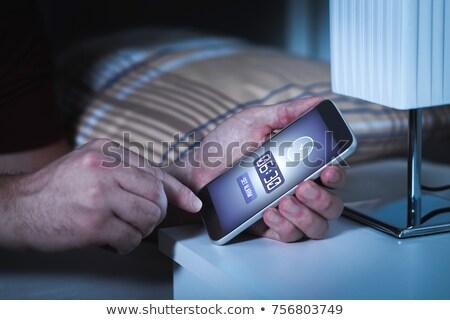 Alarming Cellphone Next To Bed Stock photo © albund