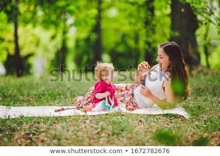 Komik genç kadın açık havada park sabun köpüğü Stok fotoğraf © deandrobot