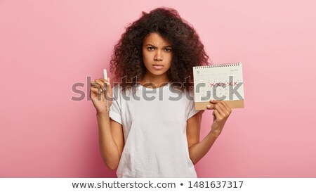 woman hold tampon for menstruation Stock photo © ssuaphoto