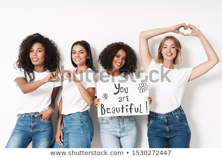 Caucasian lady holding blank with text about feminism Stock photo © deandrobot