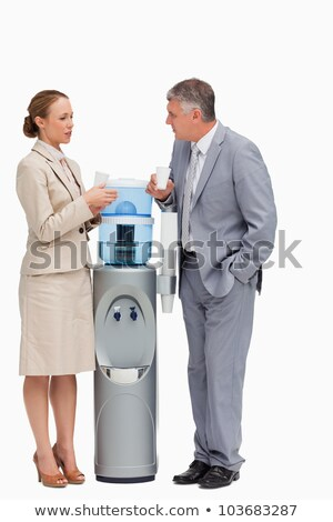 Two women standing by water cooler Stock photo © IS2