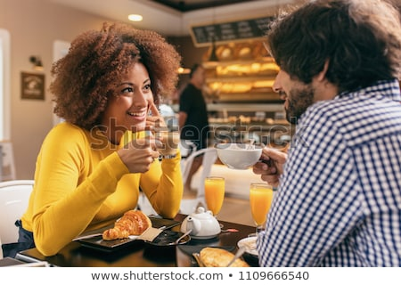 man and woman having breakfast stock photo © is2