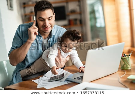 Toddler working on laptop Stock photo © IS2