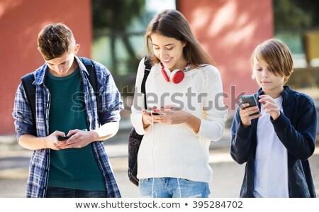 tieners · luisteren · mp3-speler · gras · tiener · park - stockfoto © is2
