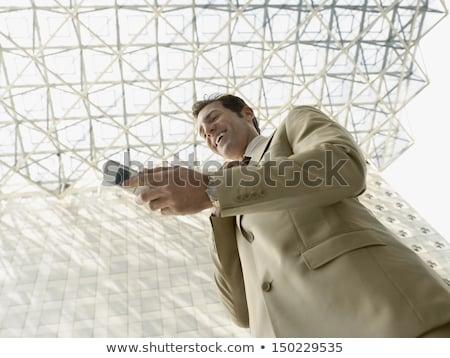 Alulról fotózva kilátás férfi olvas üzenet mobiltelefon Stock fotó © stevanovicigor