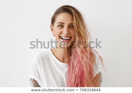 Studio portrait of happy woman with caucasian appearance smiling Stock photo © deandrobot